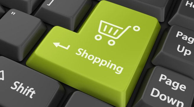 Tecla de un teclado de un ordenador con el dibujo de un carrito de compra